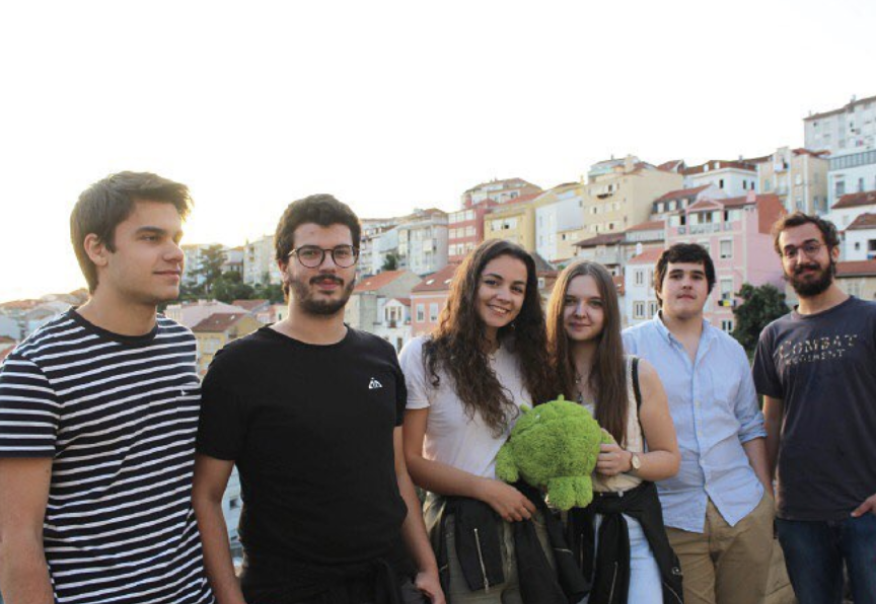 Summer interns 2019 holding the Android cuddly toy by the balcony