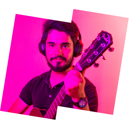 Photo of João playing his guitar with Pink backlight